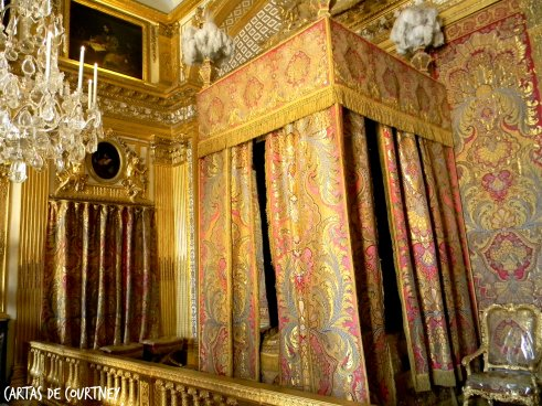 King Louis' bedroom, drapes sewn with gold thread